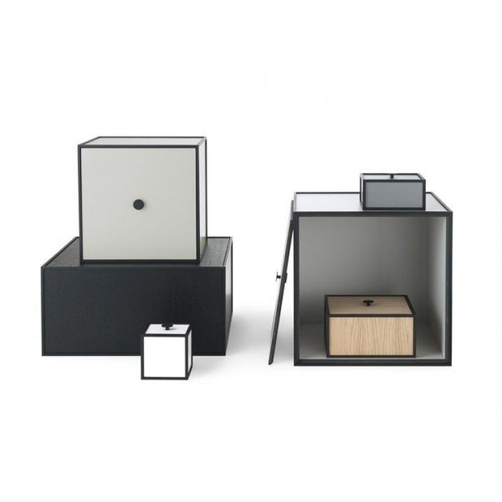 Frame is a flexible storage solution comprised of square boxes in cubic frames. The individual combination options are endless. Frame is manufactured in Denmark and created with attention to detail. Frame unites functionality, quality and aesthetics.  Measurement: 10x20x20 cm Colour: Black-stained Material: Veneer / mdf / lacquered steel