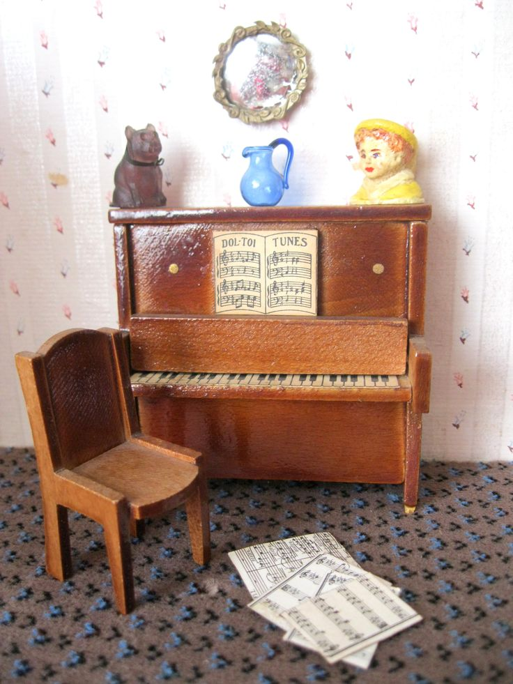 •Piano was purchased from Hamleys in Croydon in the late 1950's •Chair shape is very pleasing with curved top and front of seat. •Mirror is plastic. Some reflective paint has worn off, but it is unusual and very reminiscent of the '50's. •I'm not sure where the blue jug came from but it is modern. •The purple glass pug dog with metal collar was passed on to me with no history. Likely to be old. •The Toby jug came from Hamleys and is very well painted.