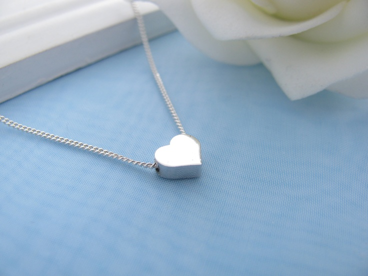 Heart Necklace- Tiny silver heart necklace- Small dainty heart necklace- delicate heart necklace. Sterling silver chain- Teen gift.. $19.80, via Etsy.