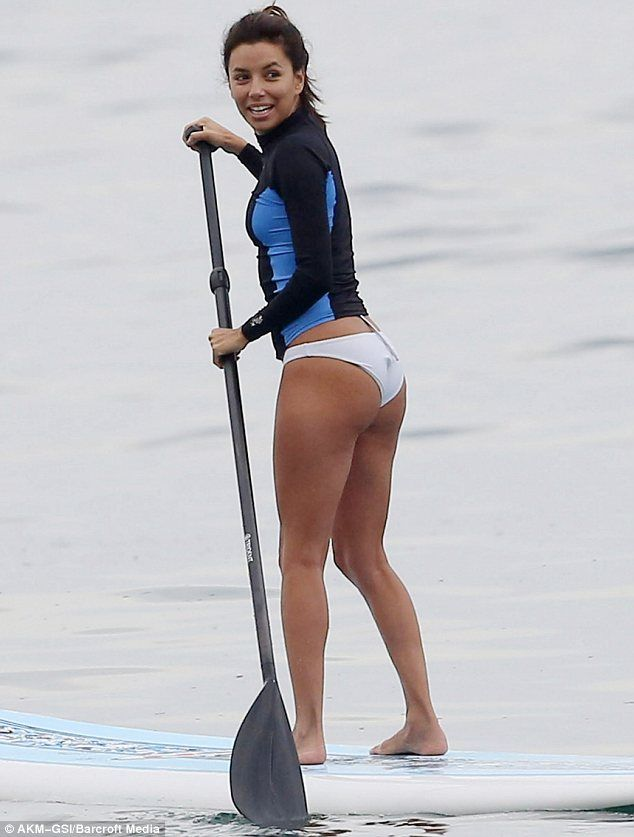 Eva Longoria spotted on a paddle board this summer.