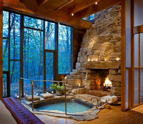 rock fireplace, indoor hot tub, floor-to-ceiling windows and a view of the woods? /brb dying