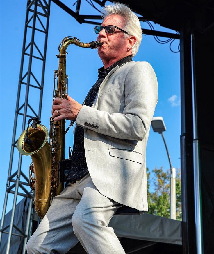 Johnny Colla one of the founding members of Huey Lewis and the News. Having loads of fun on stage. @loufest @hueylewisandthenews . . . . .  #livemusic #stagephotography #rocknroll #concertphoto #newmusic #livephotography #musiclife #rockphotography #concertphotography #audioloveofficial #musicphotography #musicphoto #livemusicphotography #concertjunkie #concertphotographer #bandphotographer #musicphotographer #concertphotos #bestband #livemusicphotographer #gigphotography…