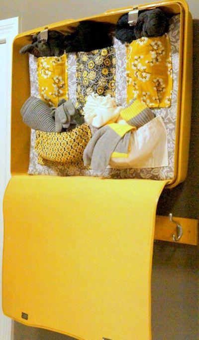Love this decorative storage idea using a vintage suitcase.