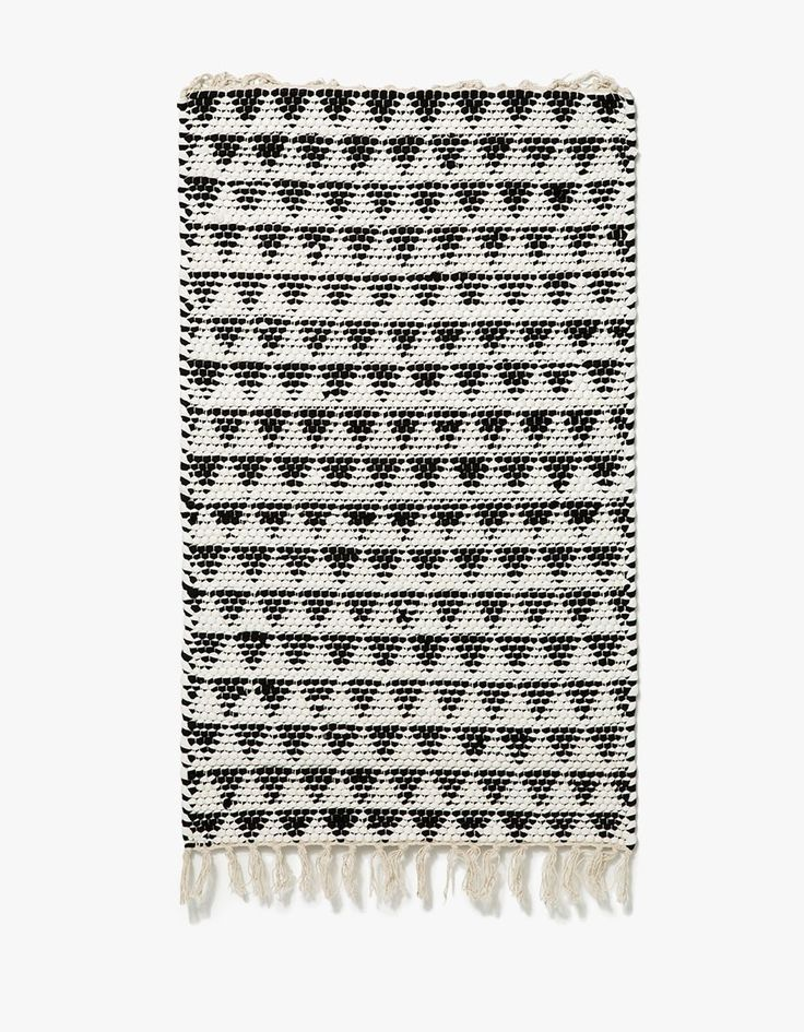 From Home of the Brave, a woven mat in Black. Featuring an organic re-purposed cotton construction, traditional geometric pattern and tassel detailing at ends.    • Woven mat in Black  • Traditional geometric pattern  • Tassel detailing  • 100% organic re