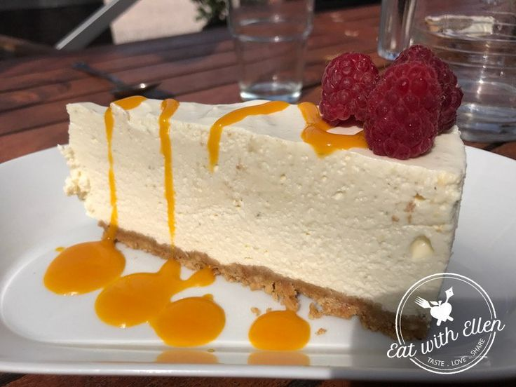An irresistible slice of passionfruit cheesecake. Creamy, airy cheese on top of a buttery, crunchy biscuit base and a generous stream of passion fruit coulis snaking its way across it, plus a few fresh raspberries to boot. Delicious. The Vineyard Kitchen at The Sharpham Estate.