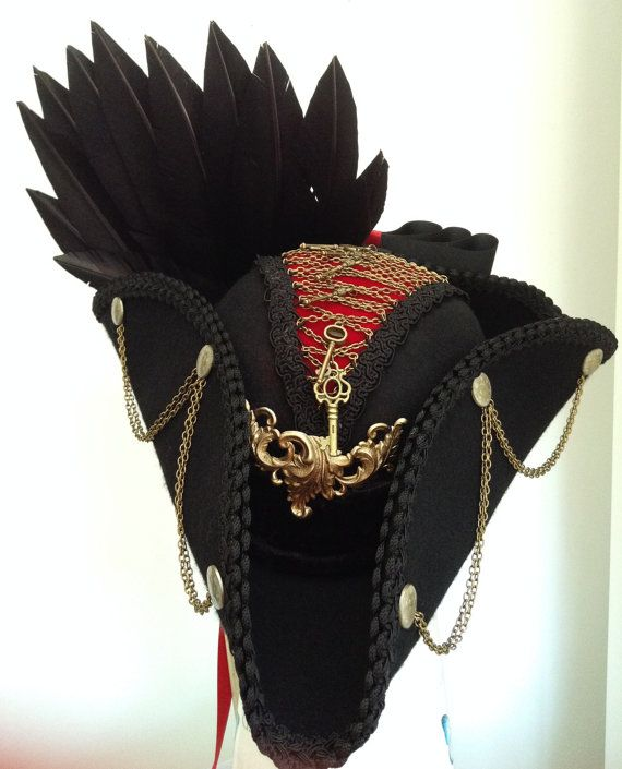Black tricorn with red velvet & brass chain & key corset top, front brass baroque plate, side brass buttons and chains, silk braid edging, rear clutch of raven feathers and a choice of black and red bow & tails or all black bow and tails  made in my own workshop in Scotland  https://www.etsy.com/uk/shop/Blackpin?ref=hdr_shop_menu | Shop this product here: spree.to/asbt | Shop all of our products at http://spreesy.com/JewelsByScarlett    | Pinterest selling powered by Spreesy.com