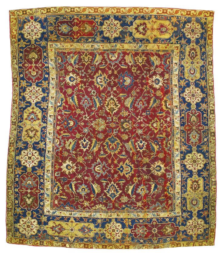 Persian rug, The Holms Hepburn Coronation rug, reduced in size, the central panel with lotus blossoms between foliate vines, the border with cartouches and medallions containing  palmette designs, 245 by 216cm., Safavid, 17th century