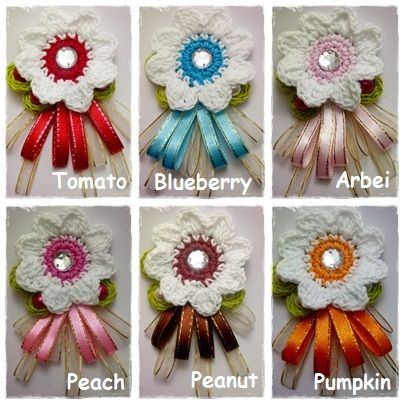 Ribbon and Crochet Brooch. We have 10 different collours! Chat us at Black Berry PIN: 7D1A19E4