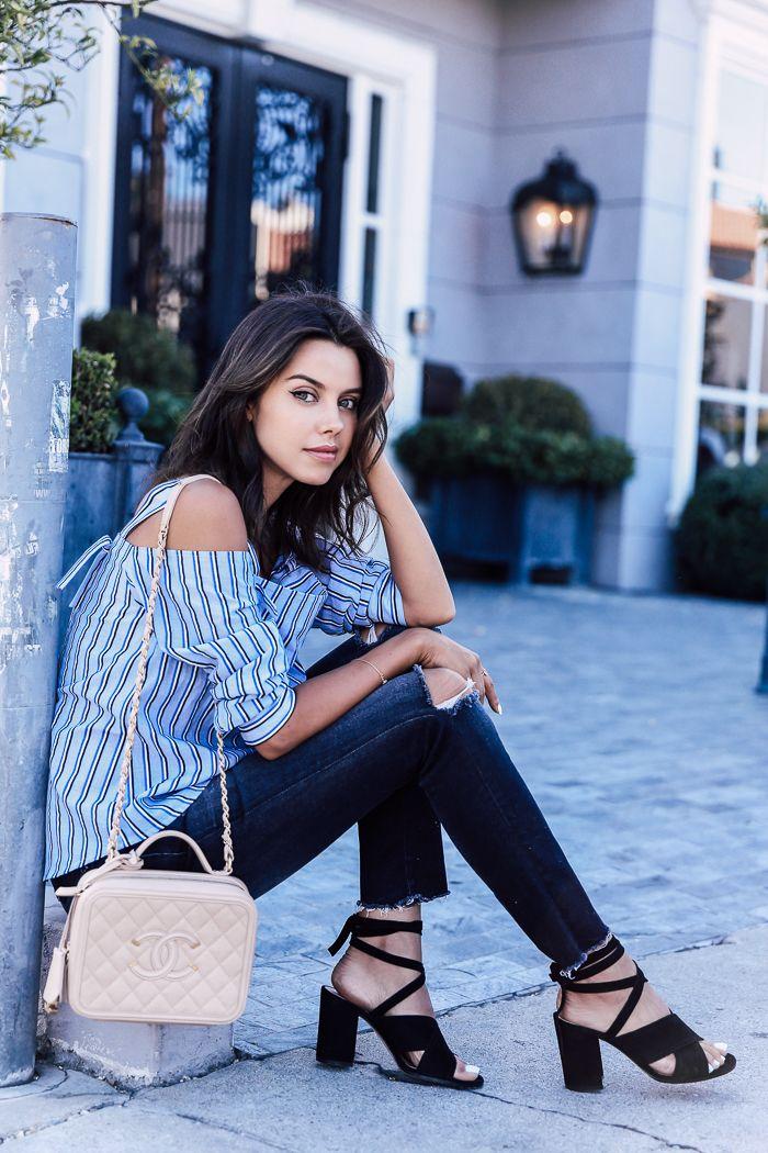 Casual summer city look - black skinny jeans + black ankle tie block heel sandals + off the shoulder blouse + Chanel vanity case bag