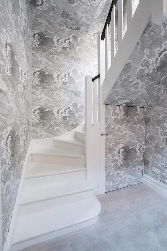 Fornasetti Nuvolette Cloud Wallpaper installed in a staircase walls and ceiling Kate Challis | Fitzroy Residence