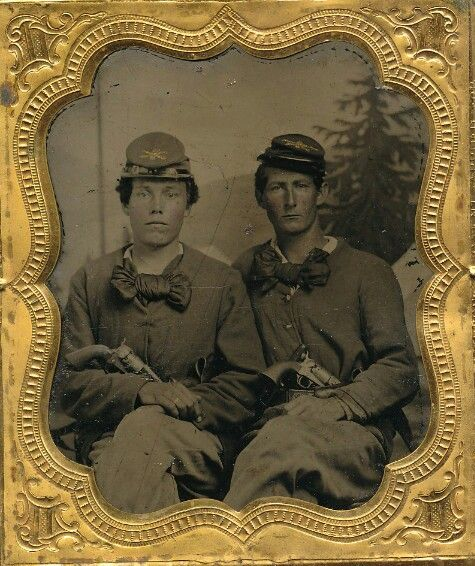"A sixth plate tintype of a pair of seasoned Federal cavalryman. The pair sit dressed nearly identical. Each sporting large silk cravats and caps with cavalry insignia, company and regimental id pinned to the top. It looks to be maybe ""22"" up there on top of the cap. Each man has a massive Colt Army tucked into his belt. (Continued in comments.)"