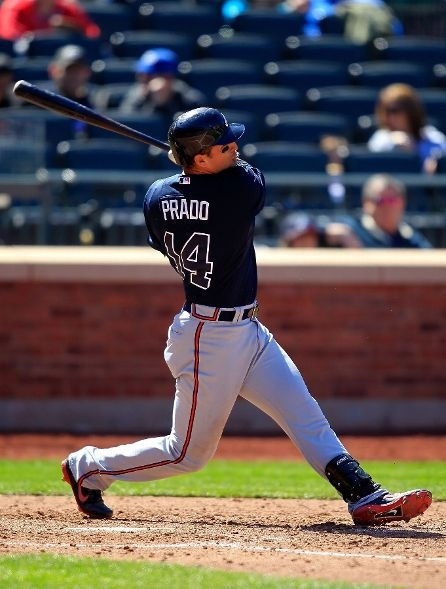 GAME 2, 4/7/12: Martin Prado of the Atlanta Braves hits a two run homer in the 5th inning against the New York Mets at Citi Field.  Braves lose 4-2.