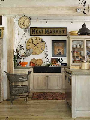Adore this farmhouse kitchen with the antique sign, cabinet for shelving, old supermarket scale. Looks less like a kitchen and more like a living space.