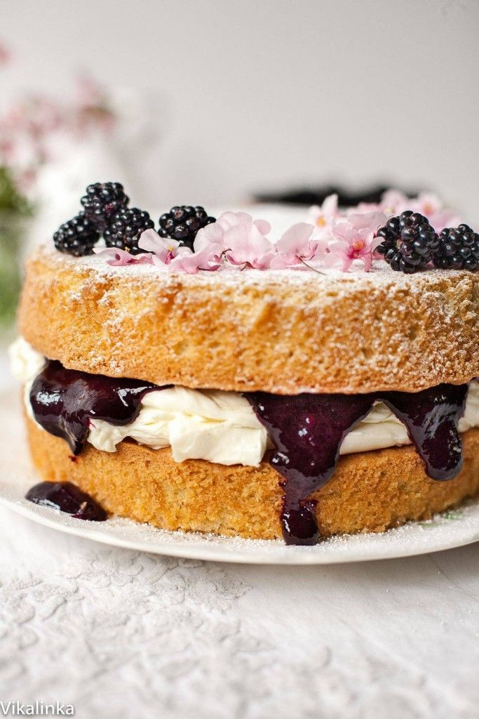 Classic British dessert Victoria Sponge Cake with mascarpone cream and wild blackberry compote.