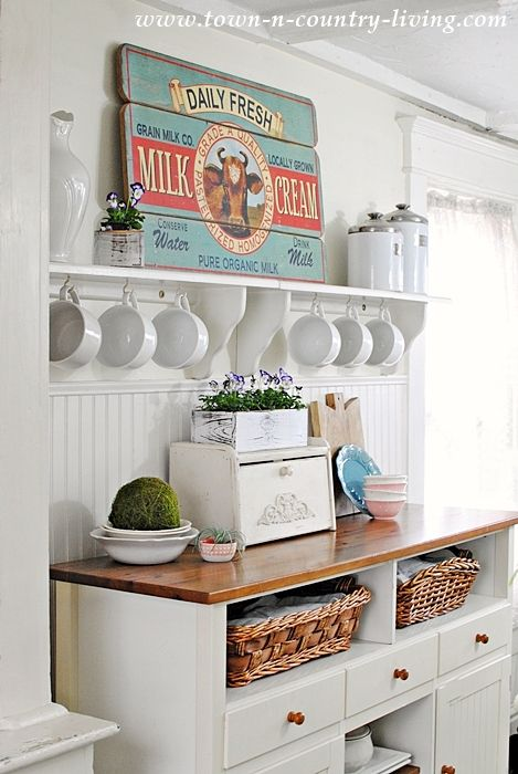 Farmhouse kitchen with open shelving and painted bead board.