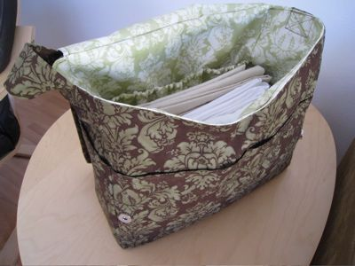 Tutorial: Hip Mama Diaper Bag | A Mingled Yarn. Skip the vinyl inner and replace with normal fabric, great tutorial for a messenger bag with multiple pockets and magnetic snap closure. Lots of photos