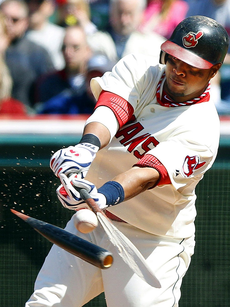 Busted! - Carlos Santana of the Cleveland Indians hits a broken bat single - his second of the game - against the Los Angeles Angels during their game at Progressive Field in Cleveland. The Indians defeated the Angels 4-0.