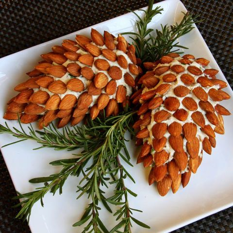 Pine Cone Cheese Ball with Almonds: This nature-inspired Christmas appetizer tastes just as delicious as it looks. It's almost too pretty to eat! Find more easy, make ahead, healthy, kid friendly, elegant and classic Christmas dinner and party appetizers, finger foods and dip recipes and ideas here.