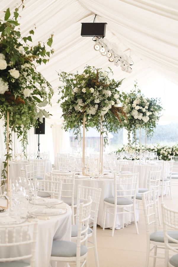 White decor and oversized greenery centerpieces: http://www.stylemepretty.com/little-black-book-blog/2016/10/31/elegant-at-home-british-wedding/ Photography: Weddings by Nicola & Glen - http://www.weddingsbynicolaandglen.com/