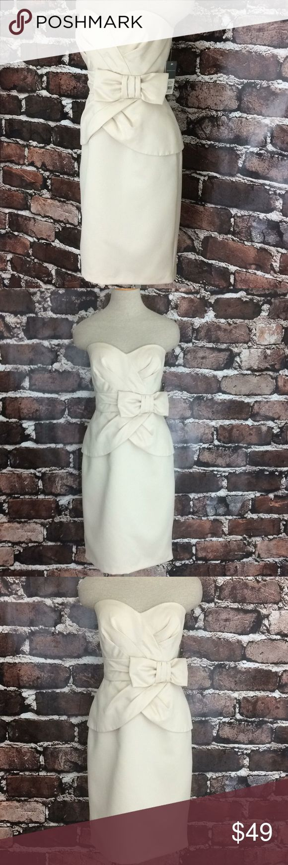 """Donna Ricco strapless midi dress bow ivory new L Donna Ricco strapless dress ivory bow midi length pencil skirt    Donna Ricco formal wear. Strapless with bow. Fully lined. Satin smooth feeling polyester. Cream in color """"bisque"""". Perfect for your celebration, or a gift.    Strapless off white dress Donna Ricco midi straight skirt new  17"""" armpit to armpit, 29"""" waist, 38"""" hips, 33"""" length Dresses Strapless"""
