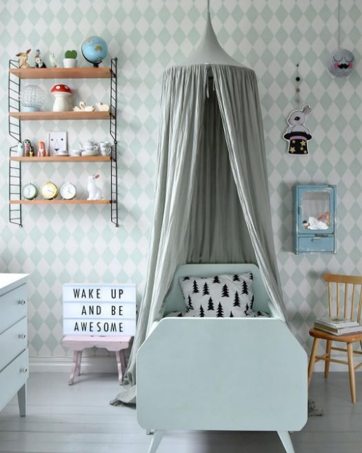 Light blue and white harlequin are wallpaper, Light blue toddler bed and canopy, Wooden shelves