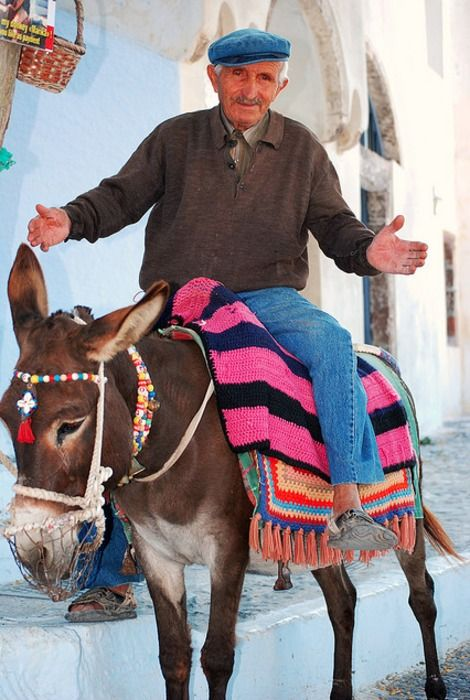 Santorini, Greece I'm pretty sure I was waiting next to this man watching the donkeys climb the steps.