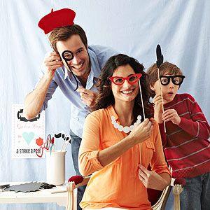 DIY photo booth with cartoon-style props you make yourself.
