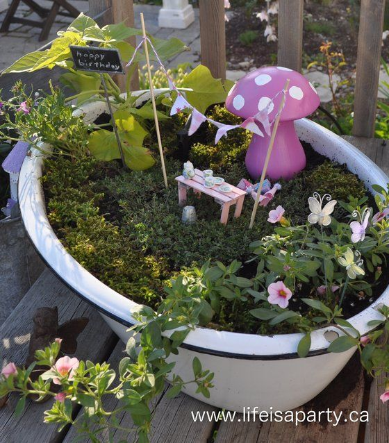 fairy garden - love the pink table out of popsicle sticks and the sweet bunting