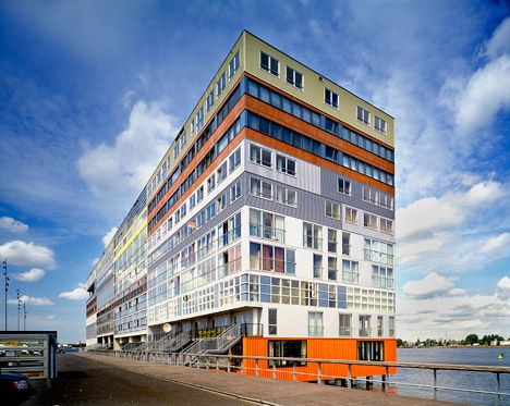 Silodam by MVRDV.  157 homes, along with workspaces, commercial units and communal areas for occupants.  Amsterdam, 2002.