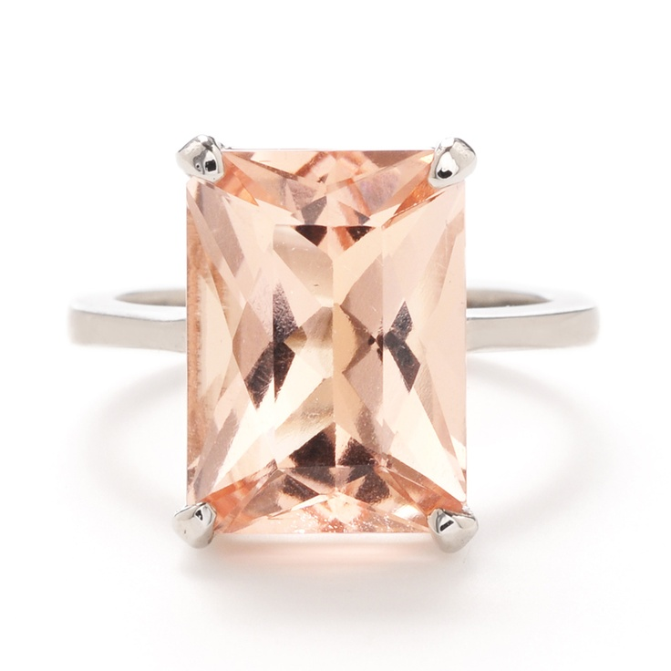 This sparkling cocktail ring features bold, pale pink morganite on a palladium band. For an ultra-colorful look, stack this ring with other gemstones.  at Greenwich Jewelers