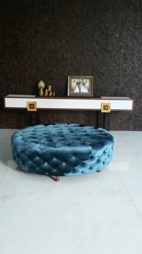 Round ottoman with smoth velvet fabric