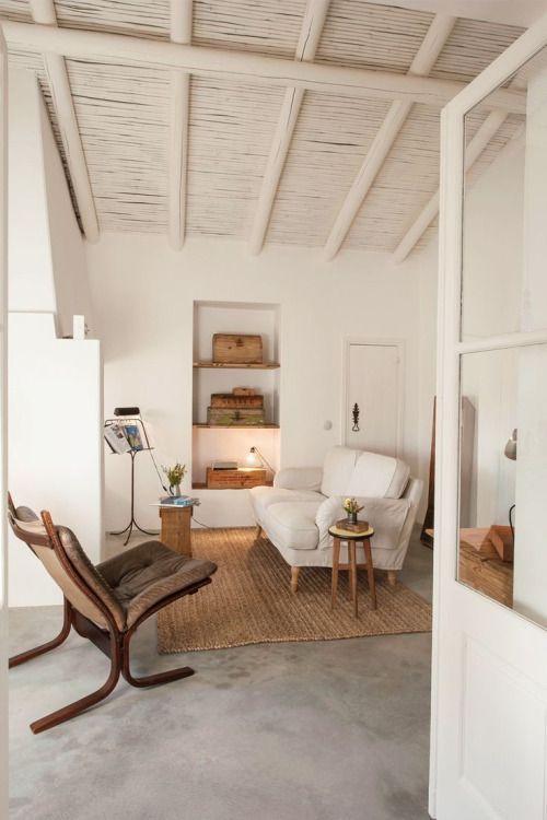 living room / white walls / cement floors