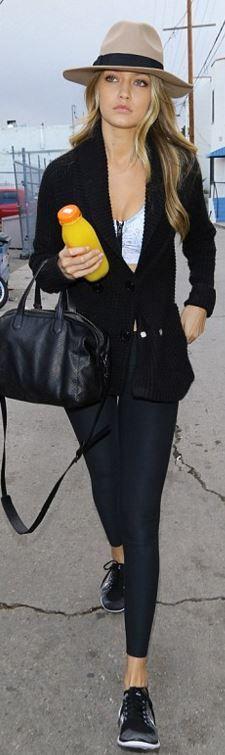 Who made  Gigi Hadid's black leather handbag, gray sneakers, and pants?