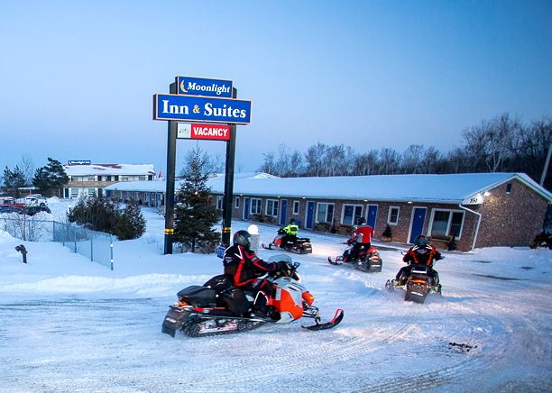 For the best location and trail access in a snowmobile friendly hotel, try staging from Moonlight Inn Sudbury, Ontario for sledding in Northeastern Ontario.