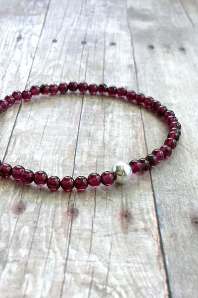 This semi precious stone bracelet features small genuine garnet stones. The stones are a deep vibrant red. This bracelet is a simply beautiful piece that you'll
