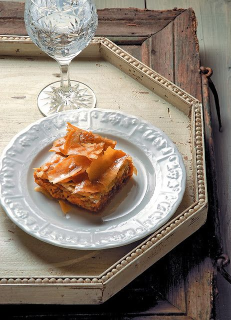 Greek-style pumpkin pie with phyllo pastry poured with honeyed syrup