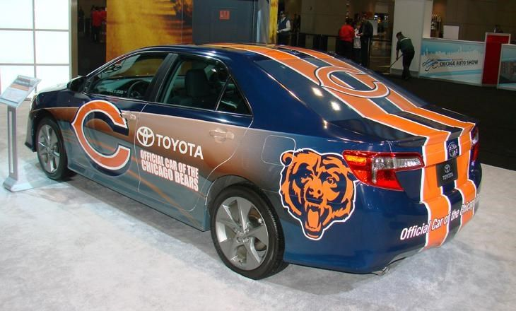 TOYOTA BEARS CAMRY: Football fans loved this 2012 Toyota Camry SE V-6 four-door sedan on display at the 2013 Chicago Auto Show. A stock model was wrapped by Modagrafics in Chicago Bears blue and orange team colors and logos. This was another promotional Camry for Chicagoland Toyota dealers to hype the fact that Toyota is the official partner of the NFL Bears.