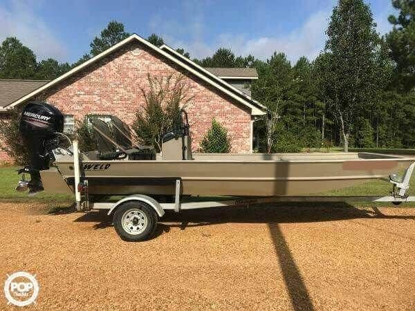 2014 Alweld flat bottom boat with 4-stroke 60 hp Bigfoot, freshly cupped and polished stainless prop, center console with grab rail, vented tunnel hul