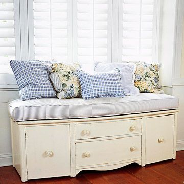 Cut the legs off an old dresser and turn it into a bench with storage. just add pillows.  Love this idea as a faux window seat.