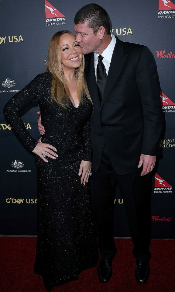 Mariah Carey gets a smooch from fiancé James Packer at the G'Day Los Angeles gala on Thursday.