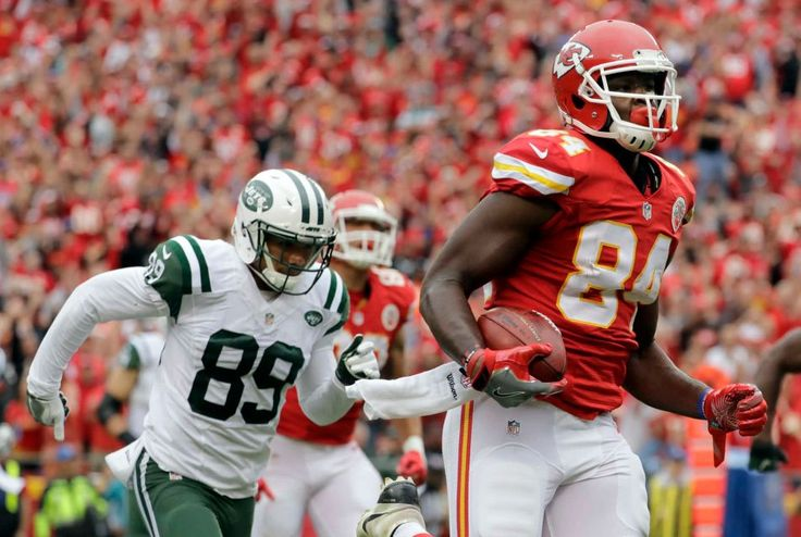Kansas City Chiefs tight end Demetrius Harris is chased by New York Jets wide receiver Jalin Marshall while running for a touchdown after a Jets fumble for a turnover during the first half of an NFL game in Kansas City, Mo., Sunday, Sept. 25, 2016.