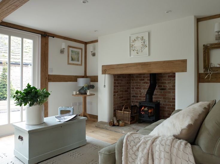 Cosy cottage inglenook fireplace, log burner, painted chest coffee table  ~ lovingly repinned by www.skipperwoodhome.co.uk