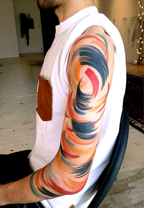 love the colors and brush stroke effect in this tattoo.