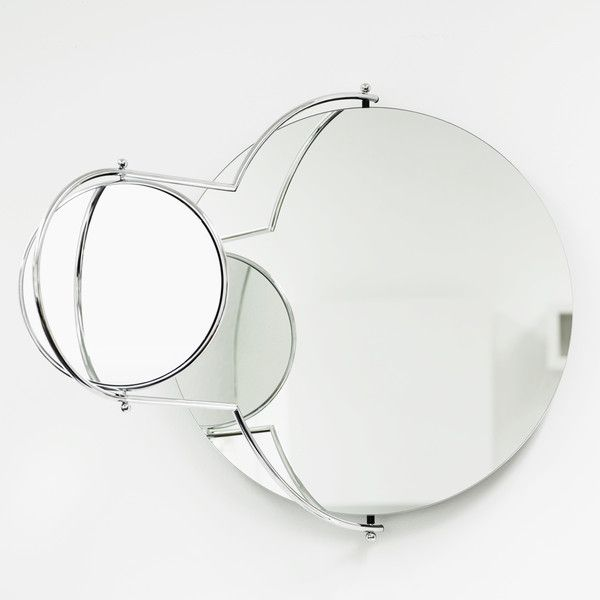 Pic On Orbit Mirror designed by Rodney Kinsman The small orbiting mirror has a magnifying mirror on its reverse