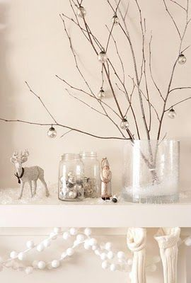 Minimalist branches in clear glass container  or Christmas decor...very simple and pretty ;)