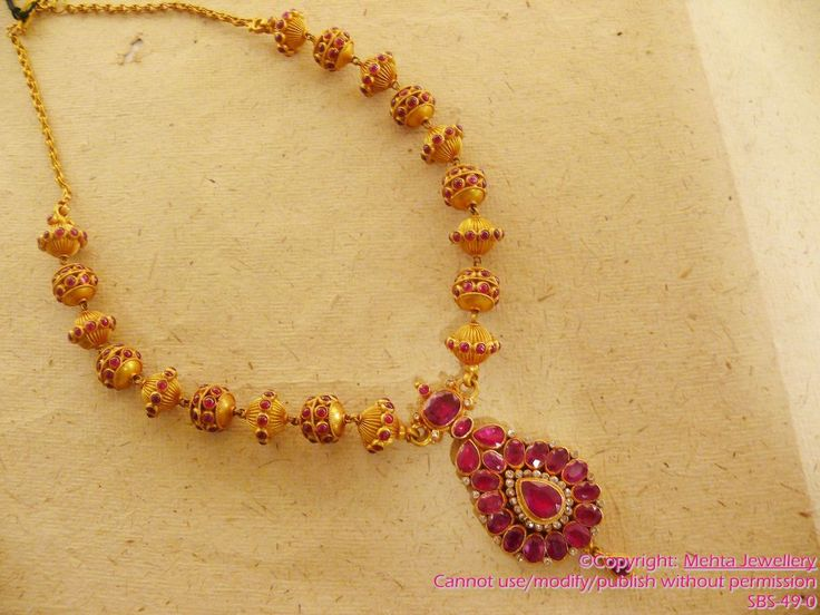 Uncut rubies and gold chunky necklace