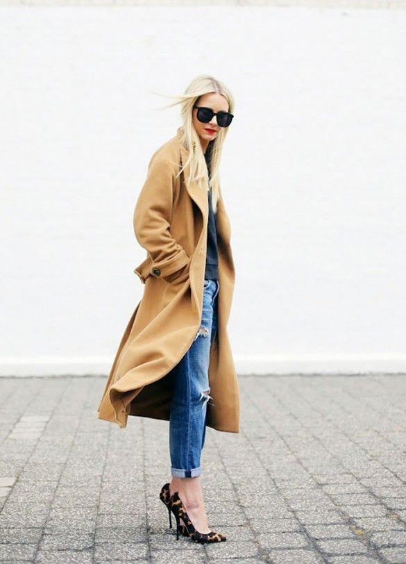 Blair Eadie wears a camel coat over a black top and boyfriend jeans, and pairs the look with oversized sunglasses and leopard heels