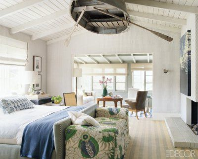 FUN! A vintage rowboat is suspended from the master bedroom ceiling.