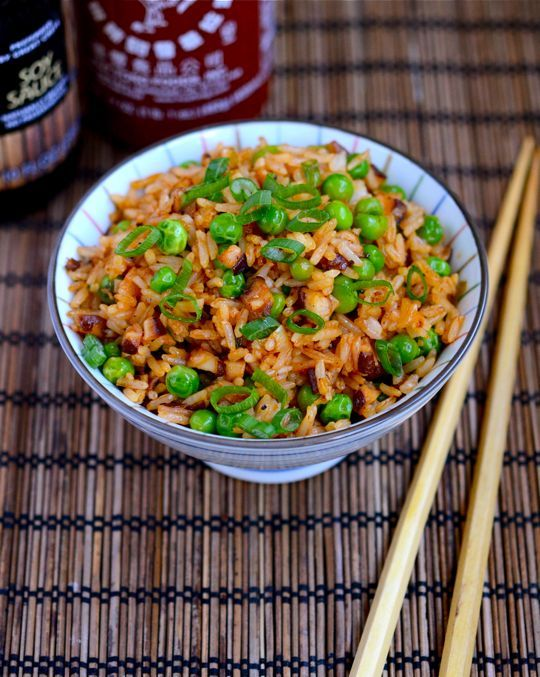 Sriracha Fried Rice - This Sriracha fried rice is vegetarian, but you can easily make it meaty by adding fresh or leftover chicken, pork, or shrimp. It's also kind of a tongue-scorcher, so if you'd like just a hint of spiciness, just cut the amount of Sriracha by half.    http://appetiteforchina.com/recipes/sriracha-fried-rice/