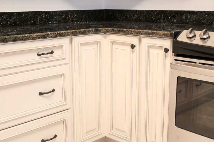 White cabinetry with dark hardware knob on lazy susan for White cabinets with black doors